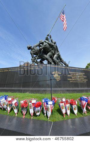WASHINGTON DC - CIRCA MAY 2013: Iwo Jima Memorial circa May 2013 in Washington DC, USA. The Memorial framed with flower bouquets during Memorial Day week.