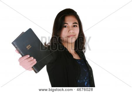 Teen Girl Holding Out Bible