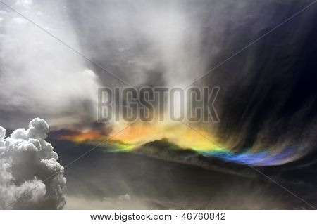 Fire Rainbow In Stormy Clouds