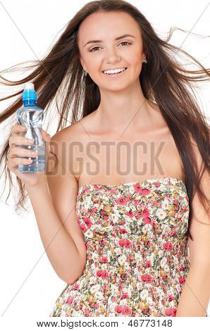 Happy beautiful girl with bottle of water on white background