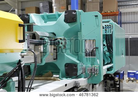 Injection moulding machine used for the forming of plastic parts using plastic resin and polymers. poster