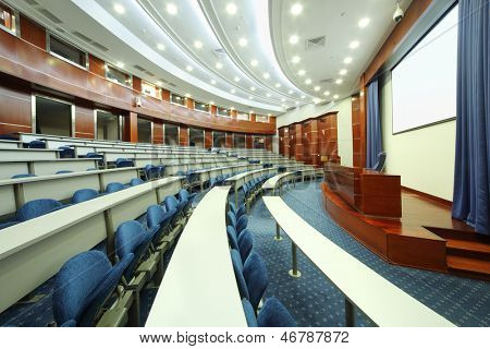 MOSCOW - AUGUST 18: Desks, blue seats, wooden rostrum in audience in MGIMO, on August 18, 2012 in Moscow, Russia. Moscow For 60 years, University has issued 30000 professionals.