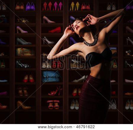 Sensual Woman in Wardrobe with Plenty of Footwear