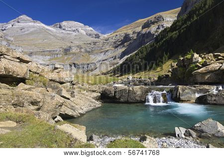 view of a waterfall and Monte Perdido peak in the valley of ordesa, Pyrenees, Huesca, Aragon, Spain