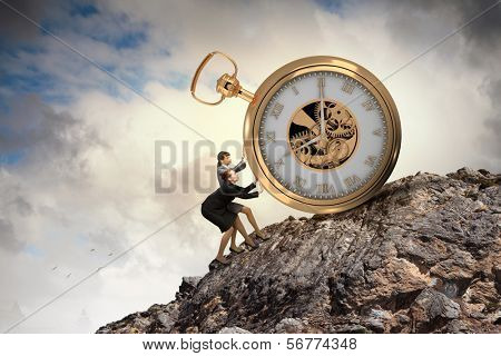 Image of attractive businesswoman and pocket watch. Time for business