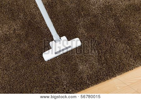Brown carpet with vacuum cleaner