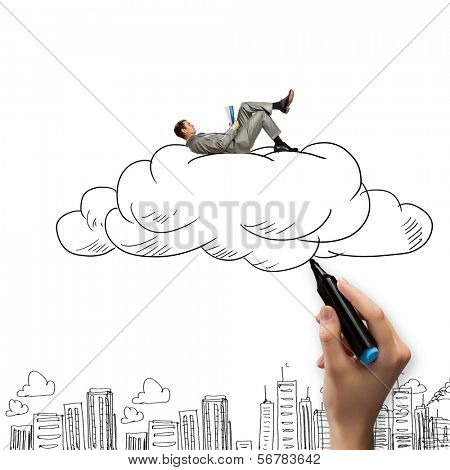 Young relaxed businessman lying on cloud and reading book