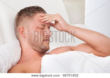 Man Waking Up With A Nasty Headache