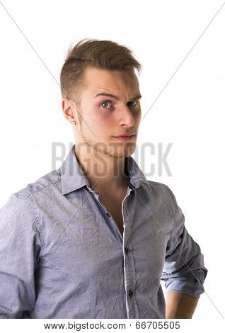 Dubious, Unsure Handsome Blond Young Man