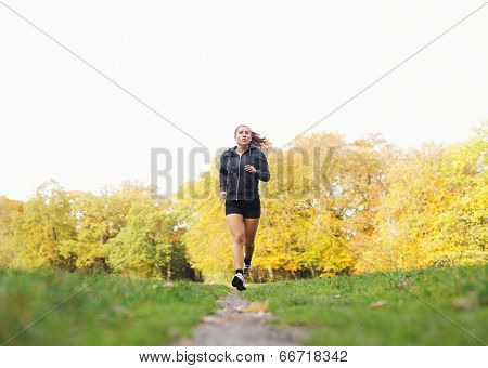 Fit And Helathy Young Woman Running In Park