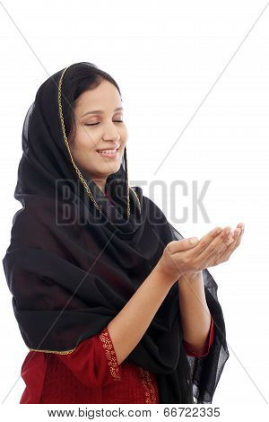 Young Muslim Woman Praying Against White