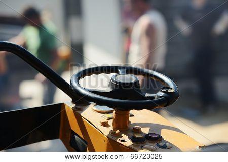 Vibrator driller vehicle
