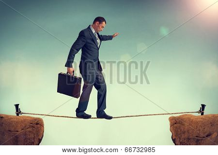 Businessman Balancing On A Tightrope