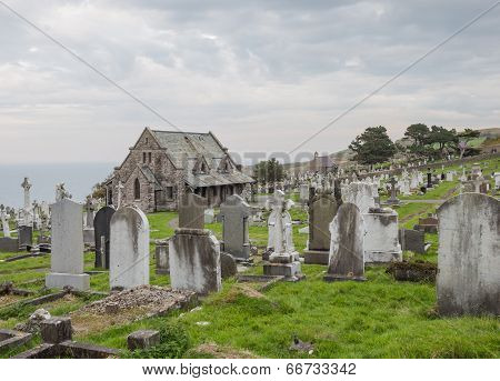 Graveyard of St. Tudno's Church on Great Orme's Head coastline in North Wales poster
