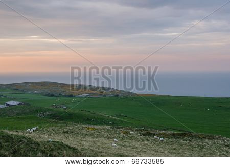 Sunset at the coastline of Great Orme's Head, a headland and nature reserve in North Wales poster