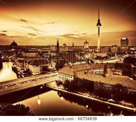 Berlin, Germany rooftop view on Television Tower, Berlin Cathedral, Rotes Rathau and the River Spree - the major landmarks at late sunset in gold tone
