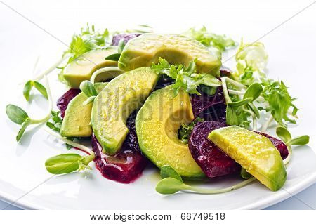 Beetroot And Avocado Salad With Lemon And Fresh Sunflower Sprouts
