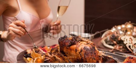 Woman's Hand With Fork And Attractive Bust With Cooked Turkey In Foreground