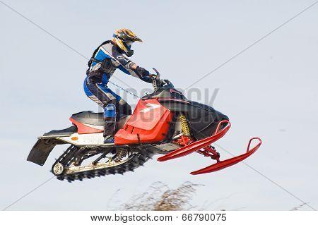 Flying sportsman on snowmobile
