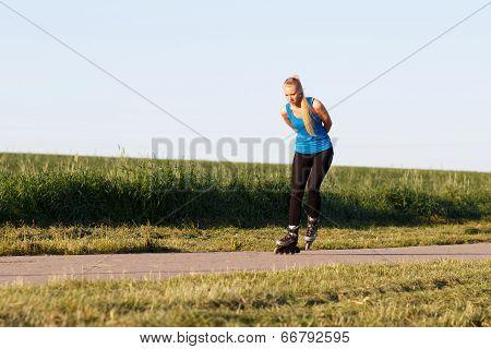 Woman Rollerblading In Summer Evening