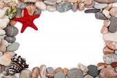 Red starfish and multicoloured pebbles isolated on white background poster