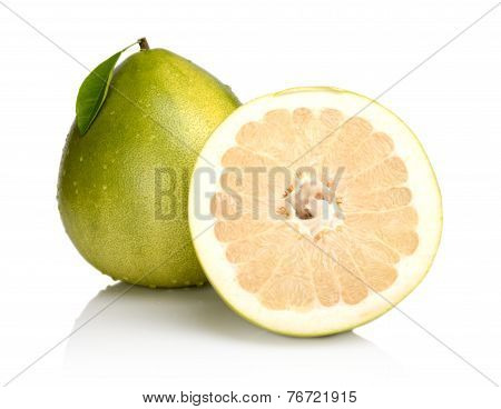 Two Pomelos,half With Drops Water And Leaf Isolated On White