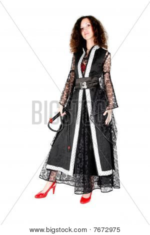 Beautiful Woman In Black Costume And Red Shoes