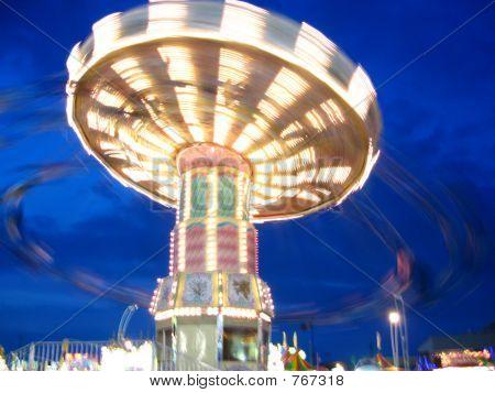 carnival swings at dusk