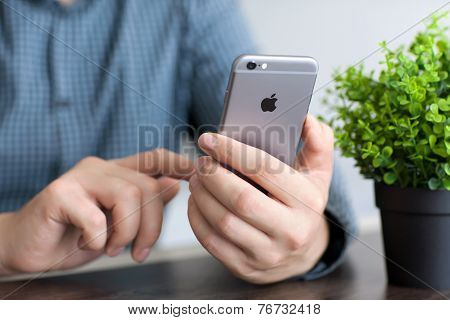Man Holding A New Iphone 6 Space Gray