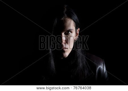Image of the brunet man with long hair on black background poster