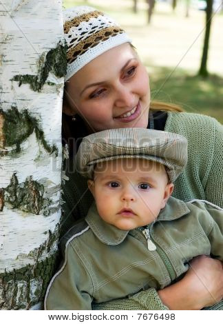 Mum And The Child In A Birch Wood.