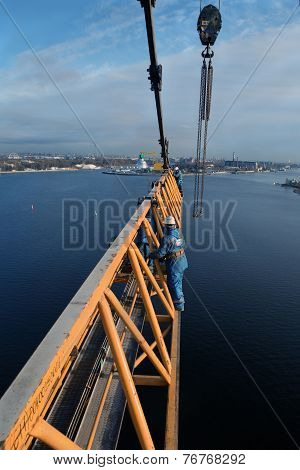 Iinstallers Steeplejacks Work On Installing Jib Construction Tower Crane.