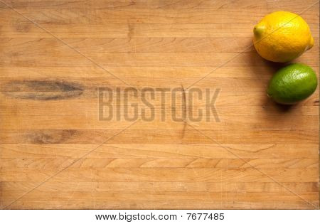 Lemon And Lime On Cutting Board