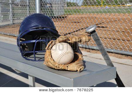 White Softball, Helmet, Bat, And Glove