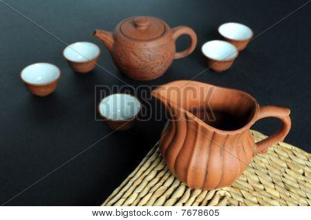 Old clay pot and tea-set