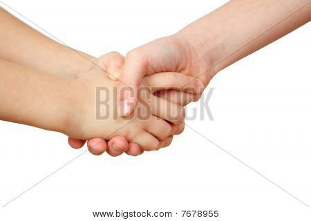 Handshake on white background. Children's hands
