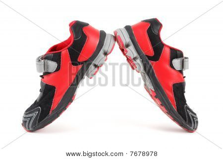 Pair of sports shoes black and red colors on white