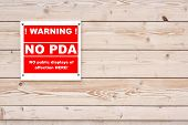 WARNING NO PDA no public display of affection Red White Sign on Timber Wall Background poster