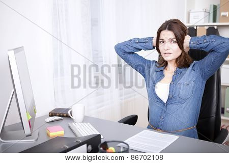 Stressed Overworked Young Businesswoman
