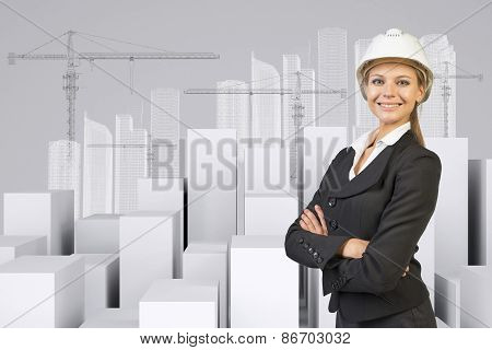 Woman with crossed arms. Cubes and wire-frame buildings