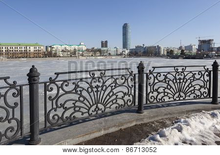YEKATERINBURG, RUSSIA. Fence waterfront city pond.