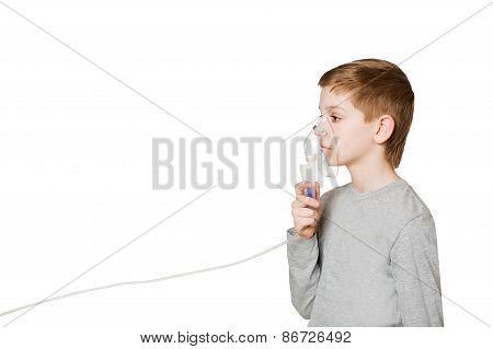 Boy Breathing Through Inhalator Mask Isolated On White