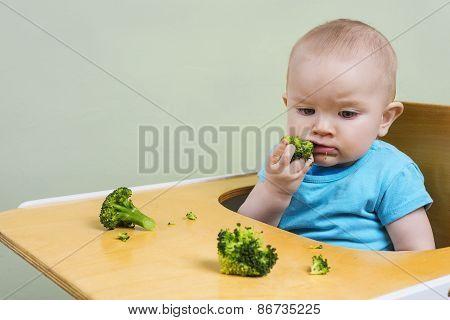 Cute Baby Tasting Broccoli