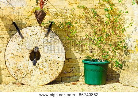 English Cottage And Old Stone Wheels