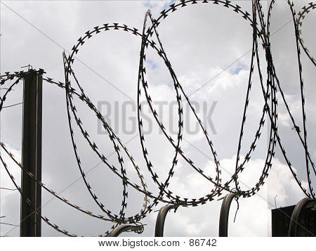 Razor Wire And Dark Clouds