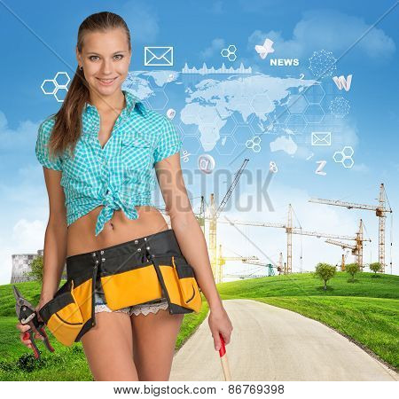 Builder in toolbelt. Green hills, road, tower cranes and virtual elements