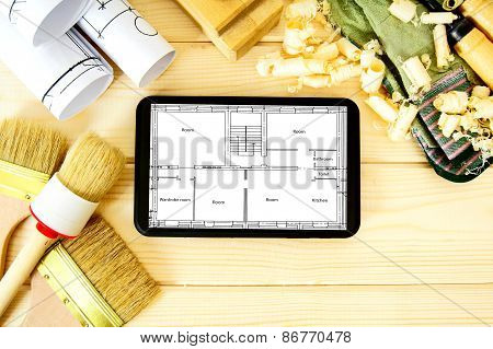 Joiner's works. Woodworking. Tablet, drawings and working tools on a wooden background.