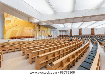 Sanctuary of Fatima, Portugal, March 07, 2015 - Interior of the modern Minor Basilica of Most Holy Trinity with a view over the altar, aisles and pews. Fatima is a major Marian Shrine for pilgrims