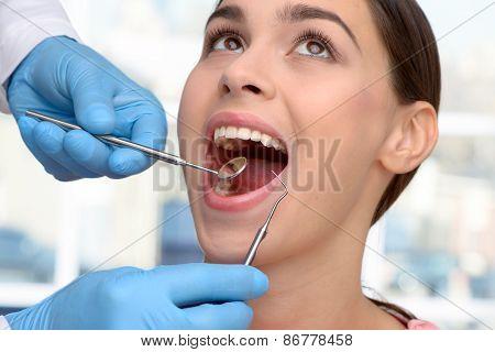 Beautiful woman visiting dentist