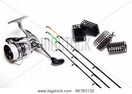 Fishing Feeder And Reel With Accessories On White Background